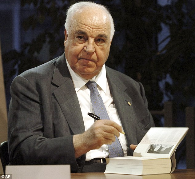 Helmut Kohl signscopies of his book 'Memories 1982-1990' in November 2005. In comments attacking Merkel's open-door policy, Kohl said Europe's peace and freedom could be at stake through mass migration