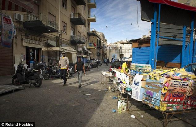 Image result for Catania Italy migrant street merchants
