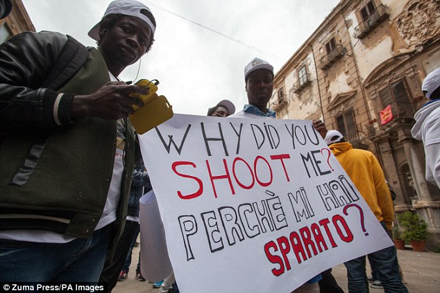 'Why did you shoot me?' Protesters highlight the shooting of the Gambian man during a altercation in Ballaró