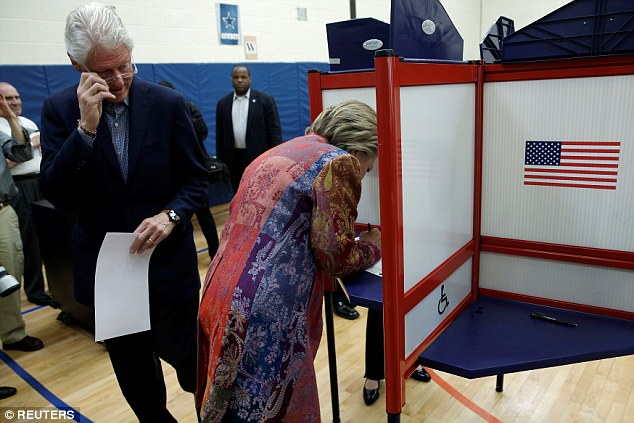 I'm with her: Bill Clinton was at his wife's side as she cast her vote in their home town of Chappaqua, in Westchester. She is heading to Manhattan later for a rally which is expected to be a victory party