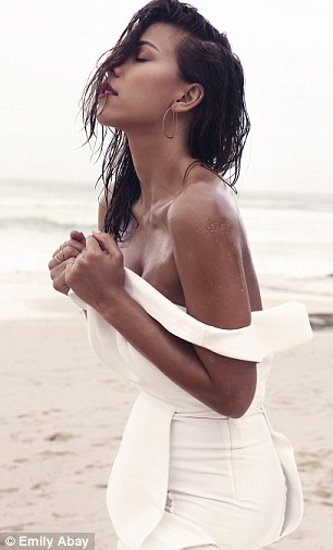 Tanned beauty: Devin showed off a deep tan and natural make-up in the stunning photographs