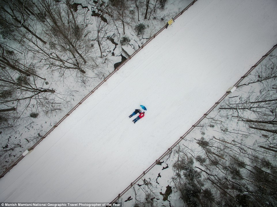 Manish Mamtani and his companion laid down on a snow-covered bridge and snapped this image from a drone (Mittersill, New Hampshire)