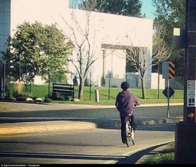 Riding on: Prince was seen riding a bicycle outside his estate in this picture posted on Instagram on Sunday