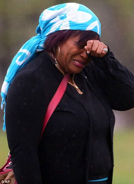 A woman named Vera weeps at Paisley Park, the home of singer Prince