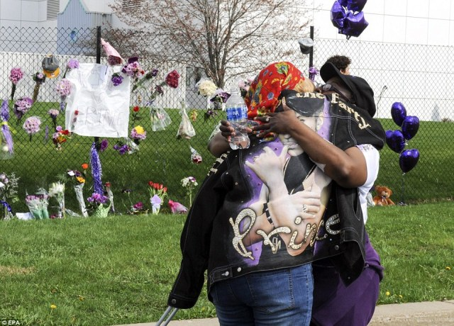 Sheila Clayton (left) of St Paul, Minnesota, hugs an unidentified friend outside of Paisley Park on Thursday after hearing news of Prince's death