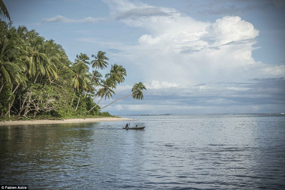 French photographer Fabien Astre, 32, spent a year documenting life on the Solomon Islands, where residents travel in dugout canoes, a boat made from a hollowed tree trunk. Astre said: 'Solomon Islanders make paddling a dugout look incredibly easy¿ but looks can be deceiving'