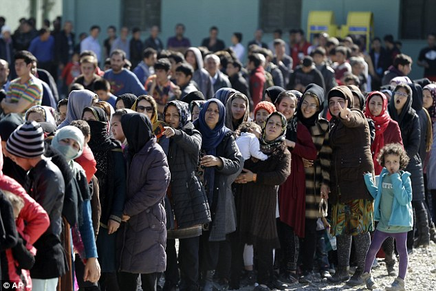 The couple, who fled Afghanistan for Austria, have nine children and receive nearly £5,000 a month in benefits.  File picture: Refugees and migrants, mostly from Afghanistan, wait in queues to receive food distributed by the Greek army as the country scrambles to cope with border restrictions imposed by Austria and Balkan countries