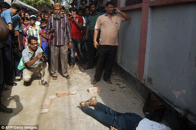 A.F.M. Rezaul Karim Siddique (pictured) was attacked on his way to the state-run university in the city of Rajshahi, where he taught English