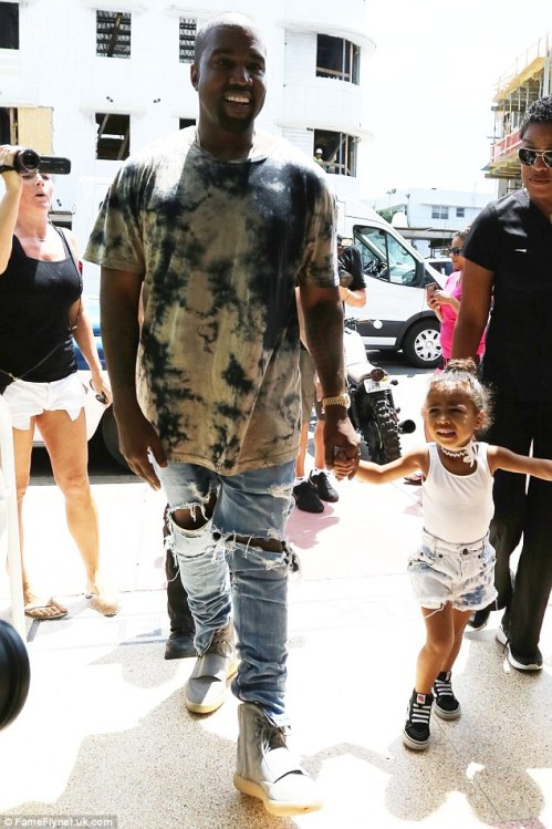 It's all cool: The rapper, 38, was unfazed by all the hoopla surrounding the family's shopping trip as he walked with his daughter