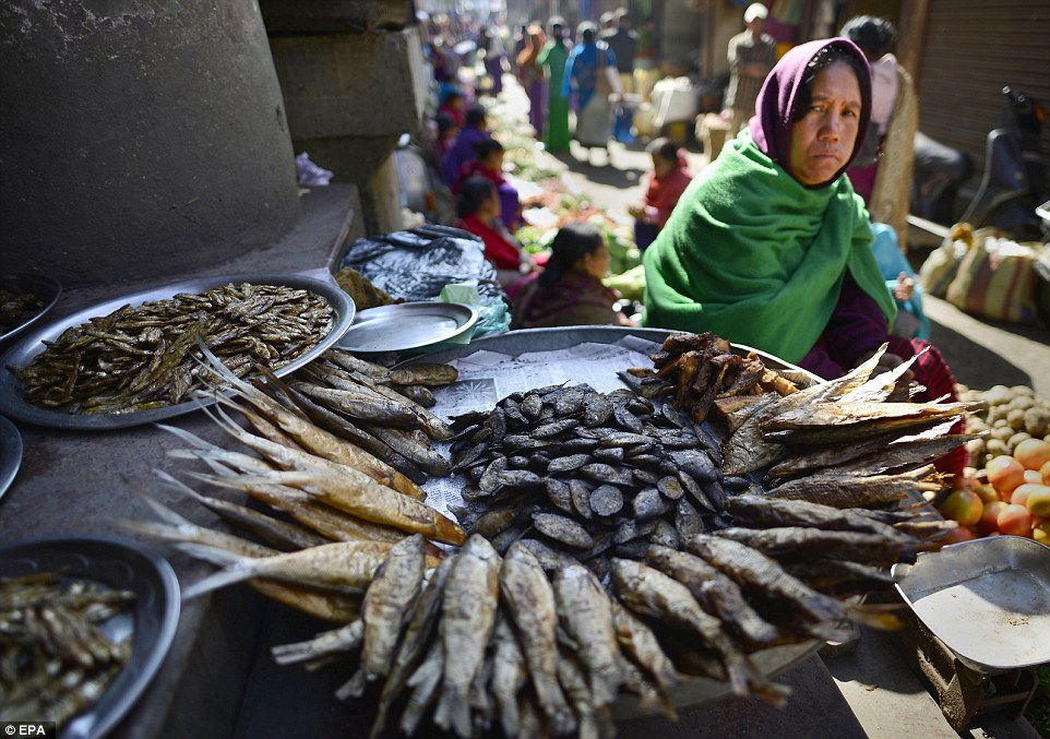 Local delicacies: A Manipuri woman sells smoked and dry fish in Ima Keithel market