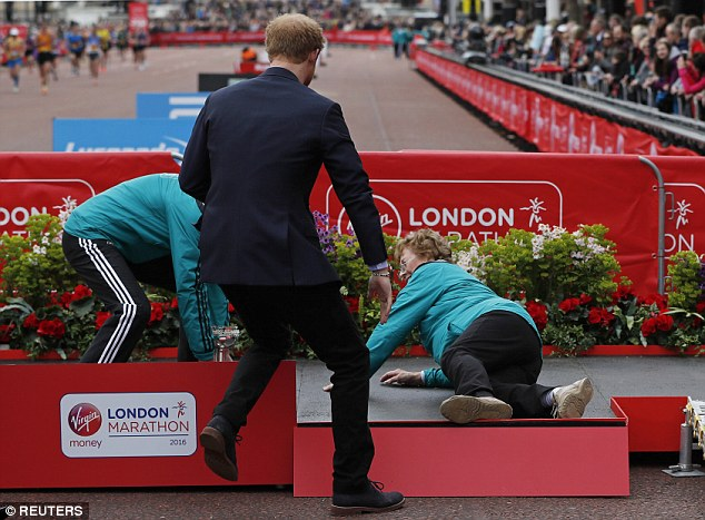 Prince Harry rushed to Sylvia's aid when she noticed she'd taken a tumble during the medal ceremony at today's London Marathon