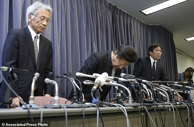 Mitsubishi president Tetsuro Aikawa (centre) and his fellow executives bows during a press conference on Tuesday when the company tried to come clean about the extent of the scandal.