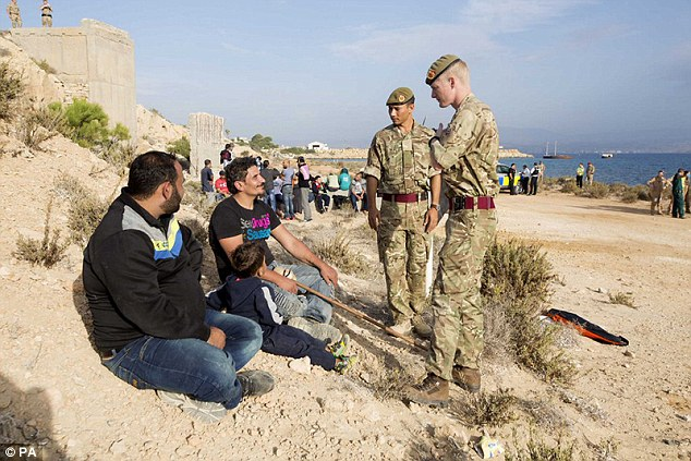 Miss Mordaunt cited the migrant crisis as a possible source of civil arrest. Pictured:armed forces personnel speaking to migrants that landed at the RAF air base at Akrotiri in Cyprus last year