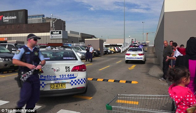 There is believed to have been eight shots fired in the car park of the shopping centre on the corner of Stacey Street and Rickard Street