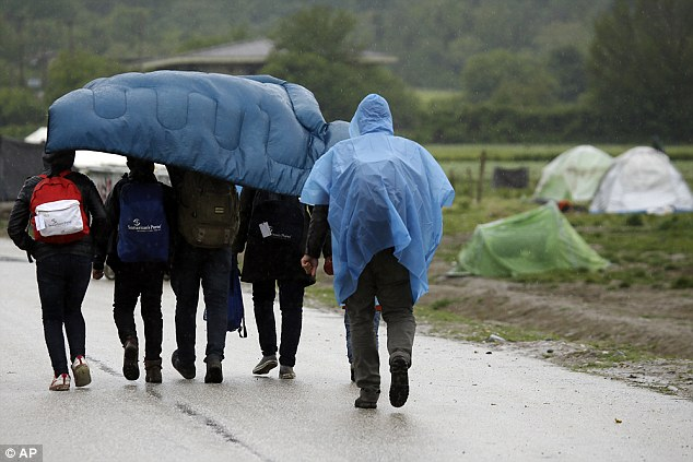 When Albania, Macedonia, Montenegro, Serbia and Turkey join the EU, another 88 million people will be eligible for NHS care and school places for their children. Pictured are migrants at the Greek-Macedonian border