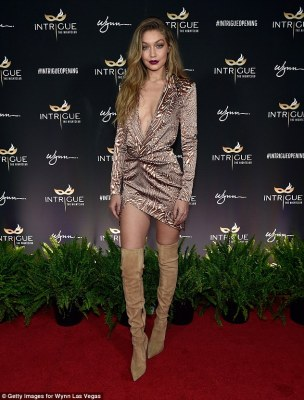 Birthday bombshell: Gigi Hadid looked utterly sensational in a plunging, thigh-scraping mini dress as she arrived for another of her 21st birthday parties atIntrigue Nightclub at Wynn Las Vegas on Saturday