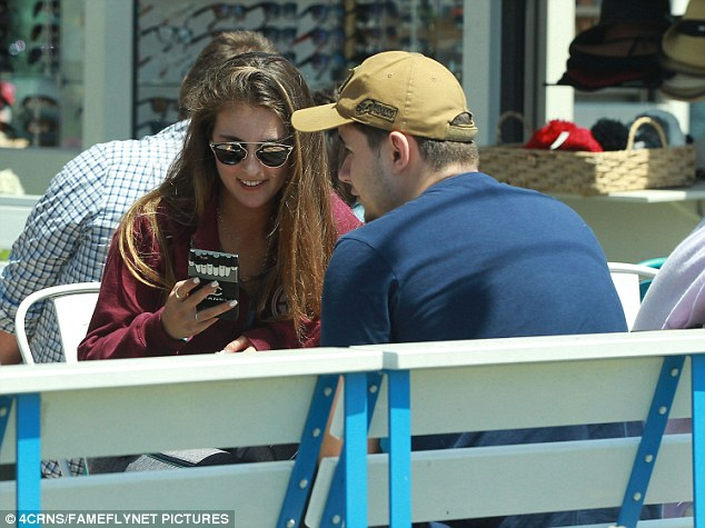 Al fresco: The 19-year-old and his friend opted to eat outside on the beautiful day and she checked her phone as they laughed and chatted in the sunshine