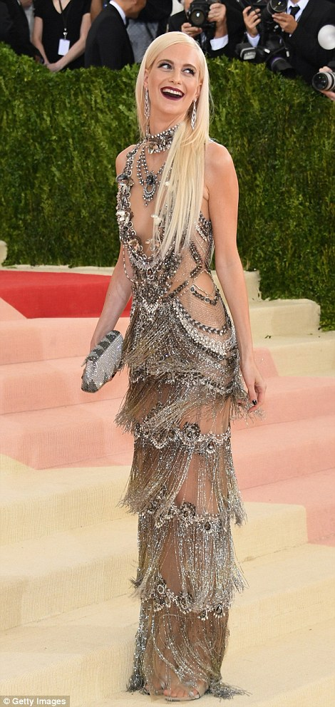 Hot metal:Poppy Delevingne arrived in a shimmering semi-sheer gown as she laughed on the arrivals carpet