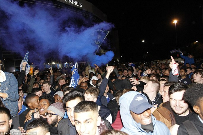 Blue smoke bombs were let off as Leicester City fans celebrated winning the league outside the King Power Stadium