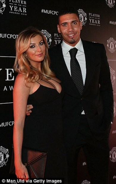 Smalling poses with girlfriend Sam Cooke on a memorable night for the defender