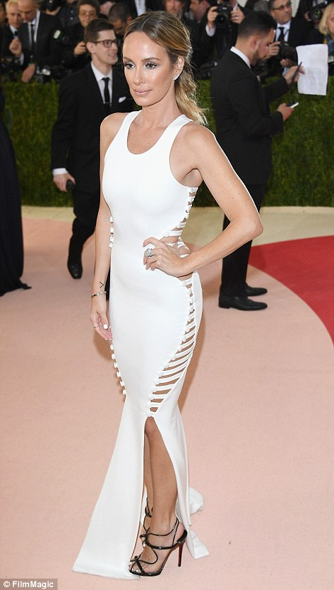 Not looking sure: Despite having such a slender, fit frame, Catt Sadler of E! News seem to be stretching the seams of her white peekaboo gown