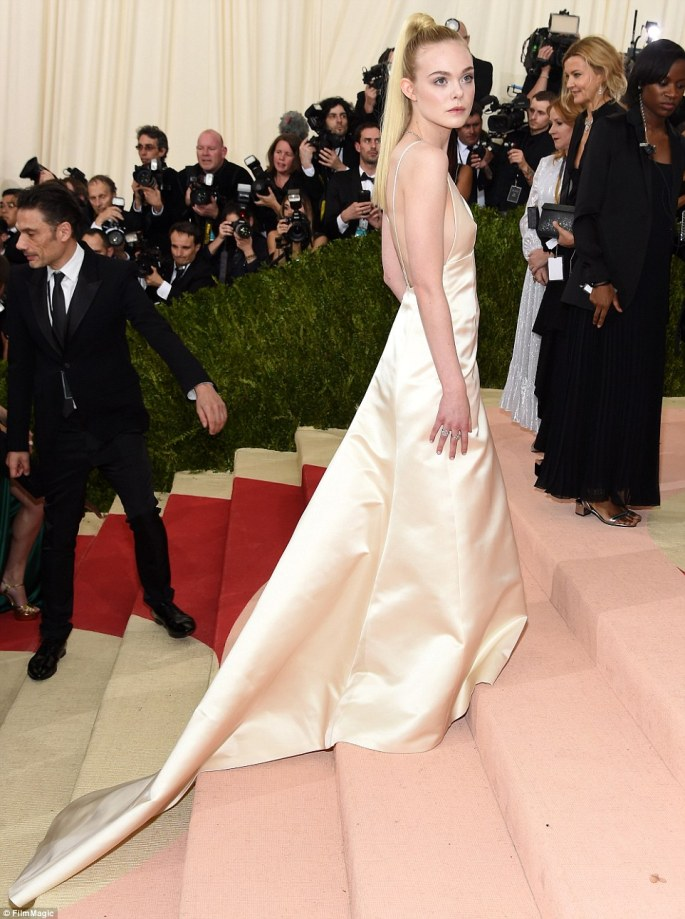 Belle of the ball: Elle Fanning wowed in cream satin as she walked the steps of the Met Museum