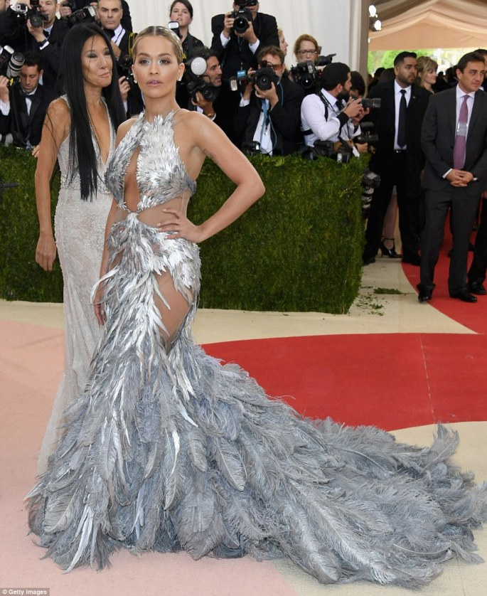 Dramatic: Rita Ora stunned in a metallic feathery creation by Vera Wang