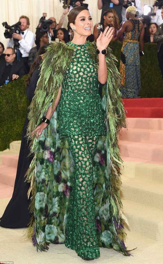 A bit too much: Actress Allison Sarofim may have gotten between a pair of feuding peacocks to complete this horrendous ensemble