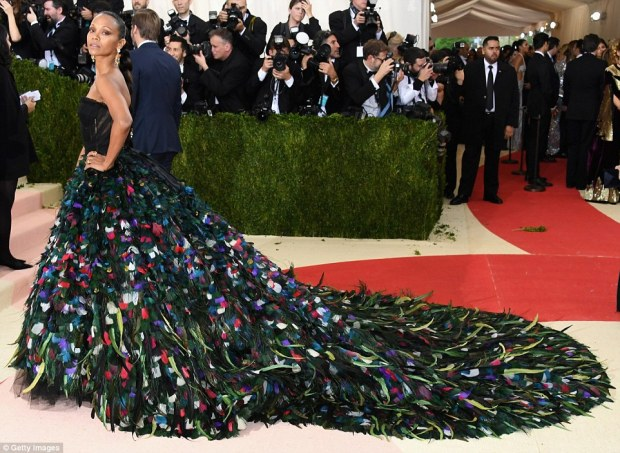 Making an entrance: Zoe Saldana sported a Dolce & Gabbana peacock-like creation with strapless bodice