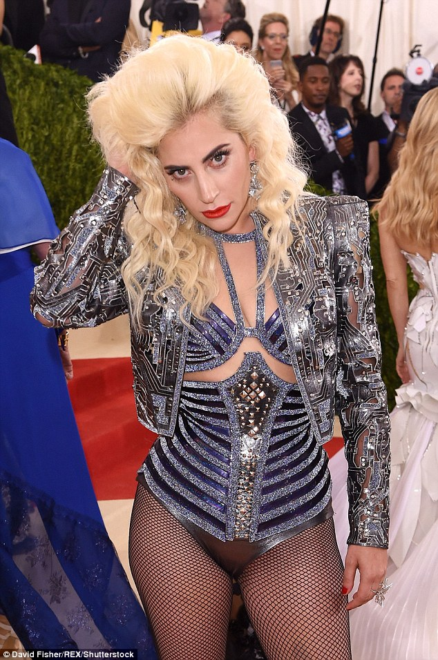 A vision from the past: The pop star wore bright lip paint and dramatic make-up as she looked to have stepped out of an Eighties hair metal music video in her anachronistic costume