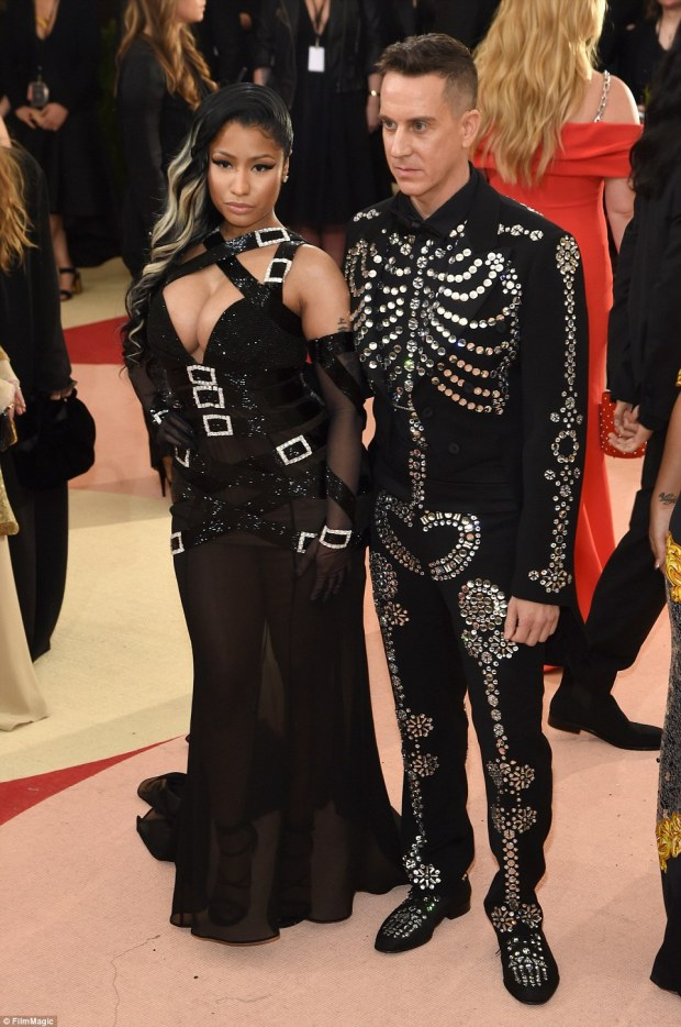Assets on show: Nicki Minaj was also happy to flaunt her flesh with another strap-covered dress featuring fake buckles, looking almost normal next to Jeremy Scott in a studded skeleton suit