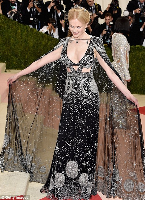 Out of this world: Nicole Kidman and Dakota Johnson's gowns had a cosmic theme. Kidman wore Alexander McQueen while Johnson chose Gucci