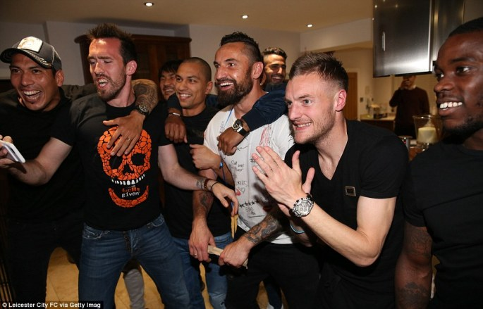 Vardy, second right, and team-mates nervously anticipate the final whistle to spark their celebrations for winning the title