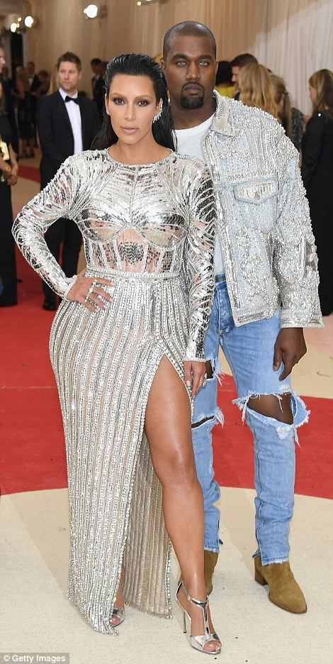 Sexy look: Kim flashed lots of leg with a thigh-high slit and showed off silver t-bar heels