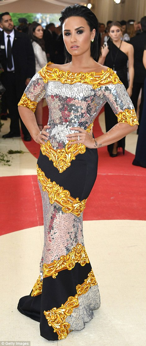 Ornate: Demi Lovato wore an eye-popping frock from Moschino that was festooned in oversized sequins and a garish gold pattern