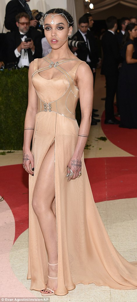 FKA Twigs - real-name Tahliah Debrett Barnett -showcased her unique style in a thigh-split nude gown