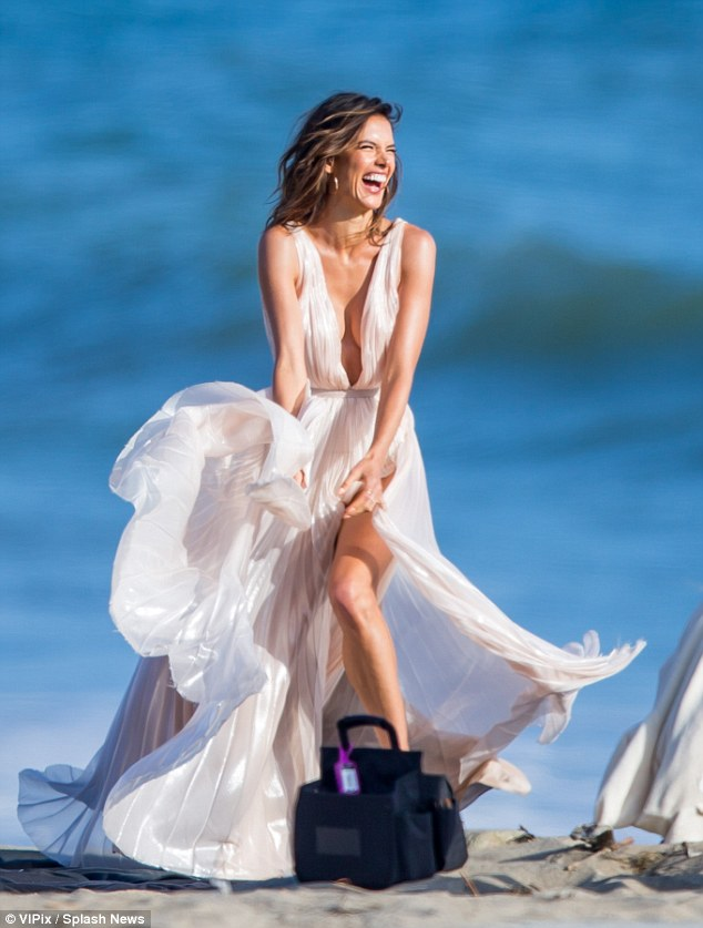 Life's a beach! Stylist Inge Fonteyne selected the nude pleated dress for Alessandra, while Carolina Gonzalez applied her make-up, and Frankie Foye tamed her windblown tresses
