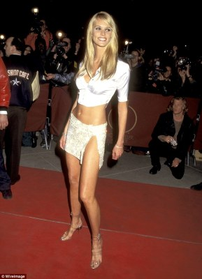 The Body:She also showed off her toned stomach by donning a cropped white silk shirt with several buttons left undone