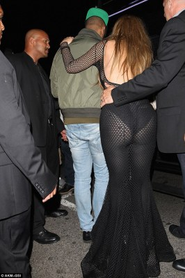 Whoops! The beauty was caught a little unawares as the photographer's flashing lights revealed her pert posterior in the daring number