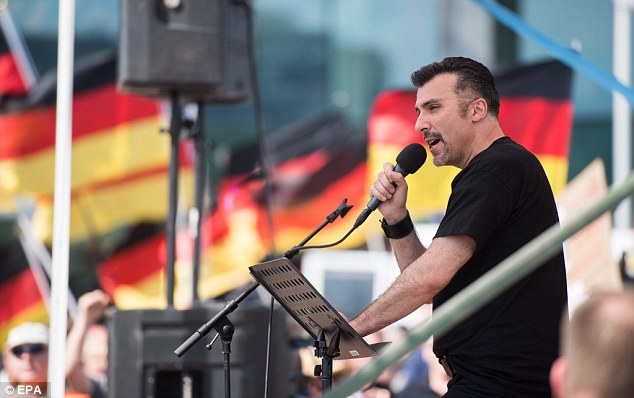 The right-wing populist Eric Graziani speaks during a demonstration with right-wing groups in front of the central train station in Berlin