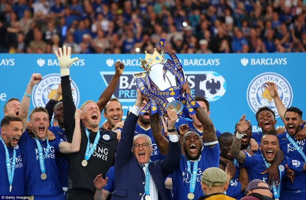 Leicester captain Wes Morgan (second right) and manager Claudio Ranieri (centre) celebrate with their historic league trophy on Saturday