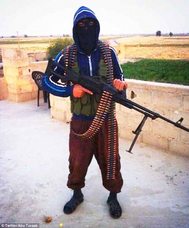 British jihadist Reyaad Khan grips a machine gun while clad in bullets. He was killed in Syria from an RAF drone