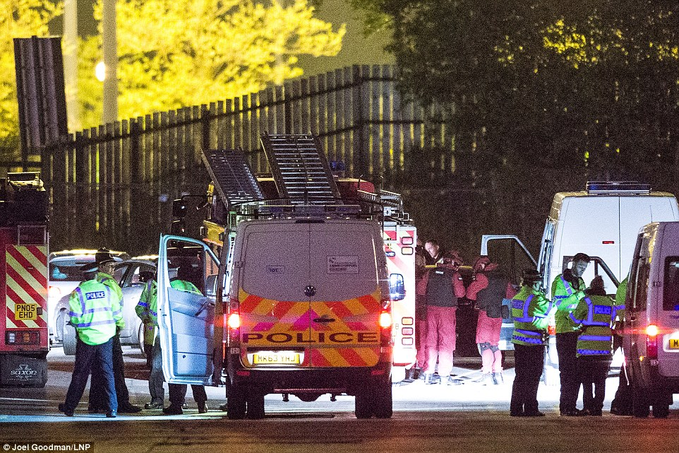 Real thing: A squadron of police cars, fire engines and ambulances raced to the scene, while masked counter-terror officers made their way inside hoping to gain control and quell the deadly assault - an operation which is believed to have been ongoing until 6am