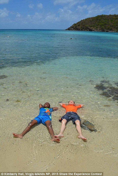 Two kids relaxing at Maho Bay in Virgin Islands National Park which was the Every Kid in a Park Winner