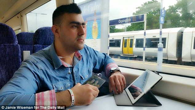 Easy rider: Nasiri travelling through Orpington, south-east London on the train