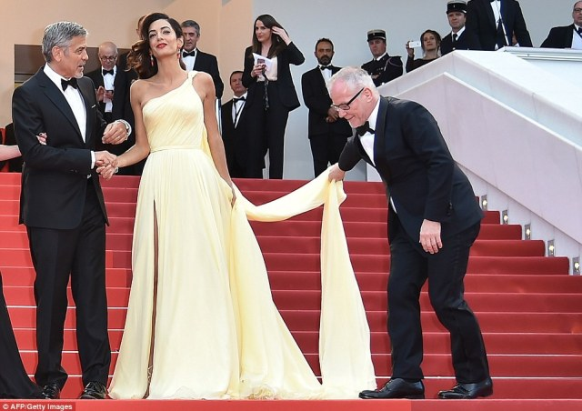 Helping hand: Cannes Film FestivalGeneral Delegate Thierry Fremaux stepped up to help Amal adjust her dress on the famous steps
