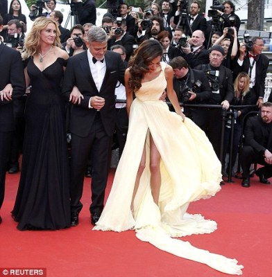 Leggy lady: Amal, 38, was the centre of attention as she arrived at the Palais des Festivals et des Congrès thanks to her striking gown