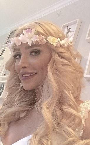 Her blonde hair was hidden under a black chador