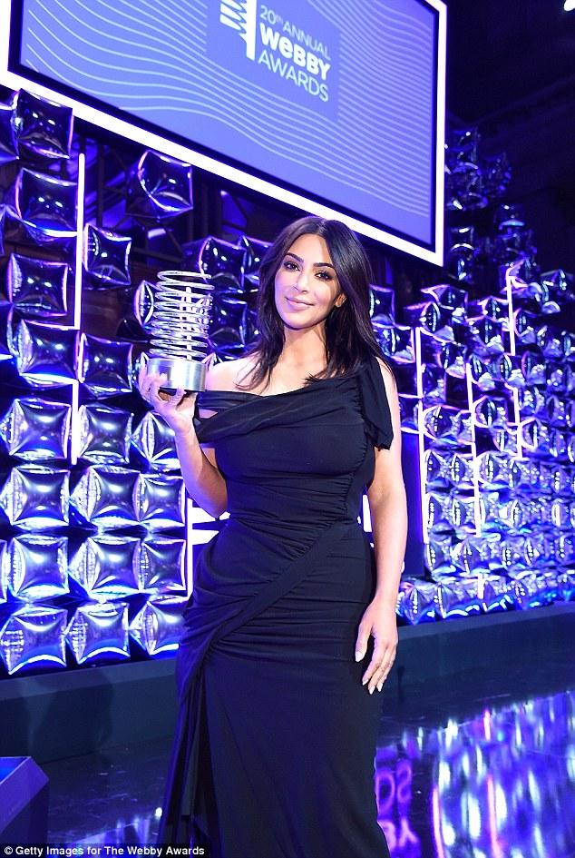 Web sensation: Break the Internet Winner, Kim Kardashian proudly posed with her award