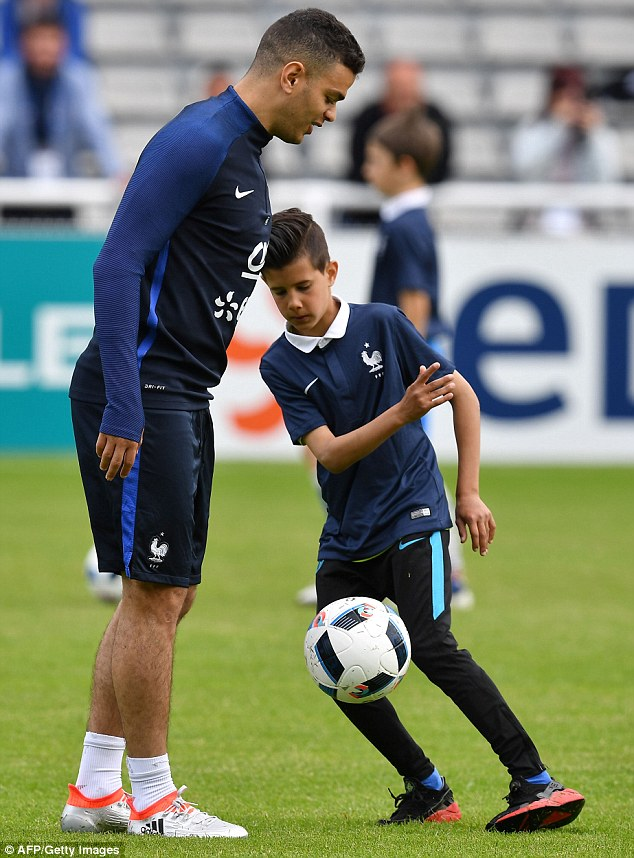 The Nice midfielder who is being monitored by Barcelona watches as a young French player shows his skills